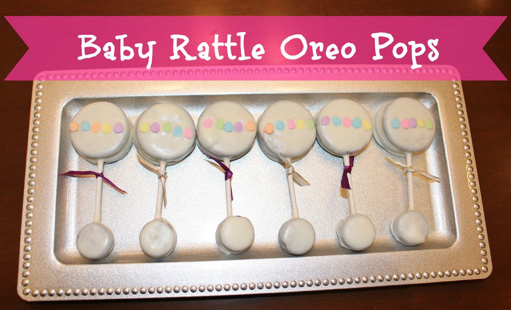 baby shower dessert ideas baby rattle oreo pops via littlemisskate