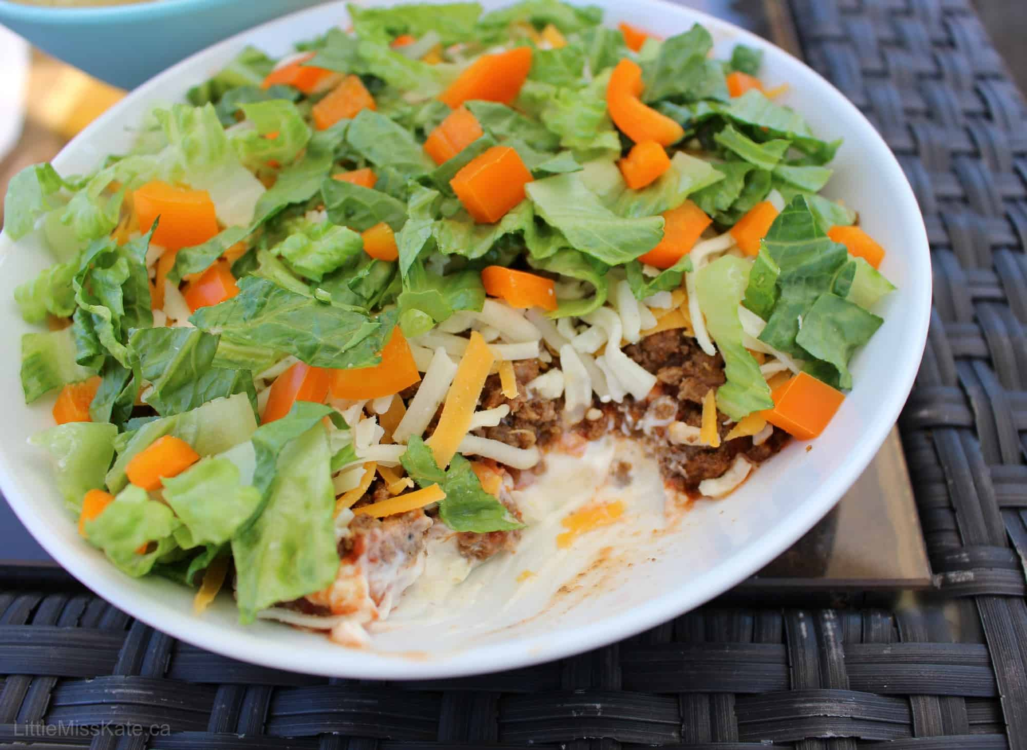 Make this Beef Taco dip for your next BBQ and you won't be worried ...