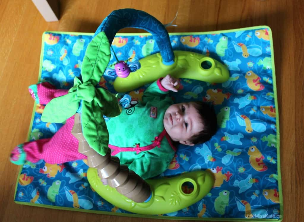 evenflo triple fun exersaucer review play mat