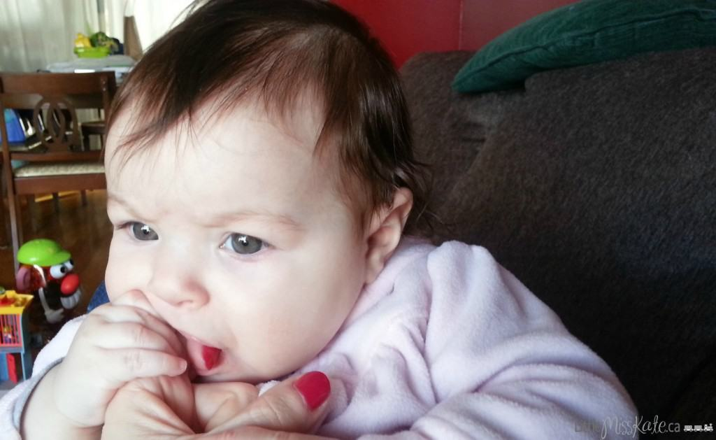 how to help a teething baby chewing on hands Munch mitt baby teether review photo