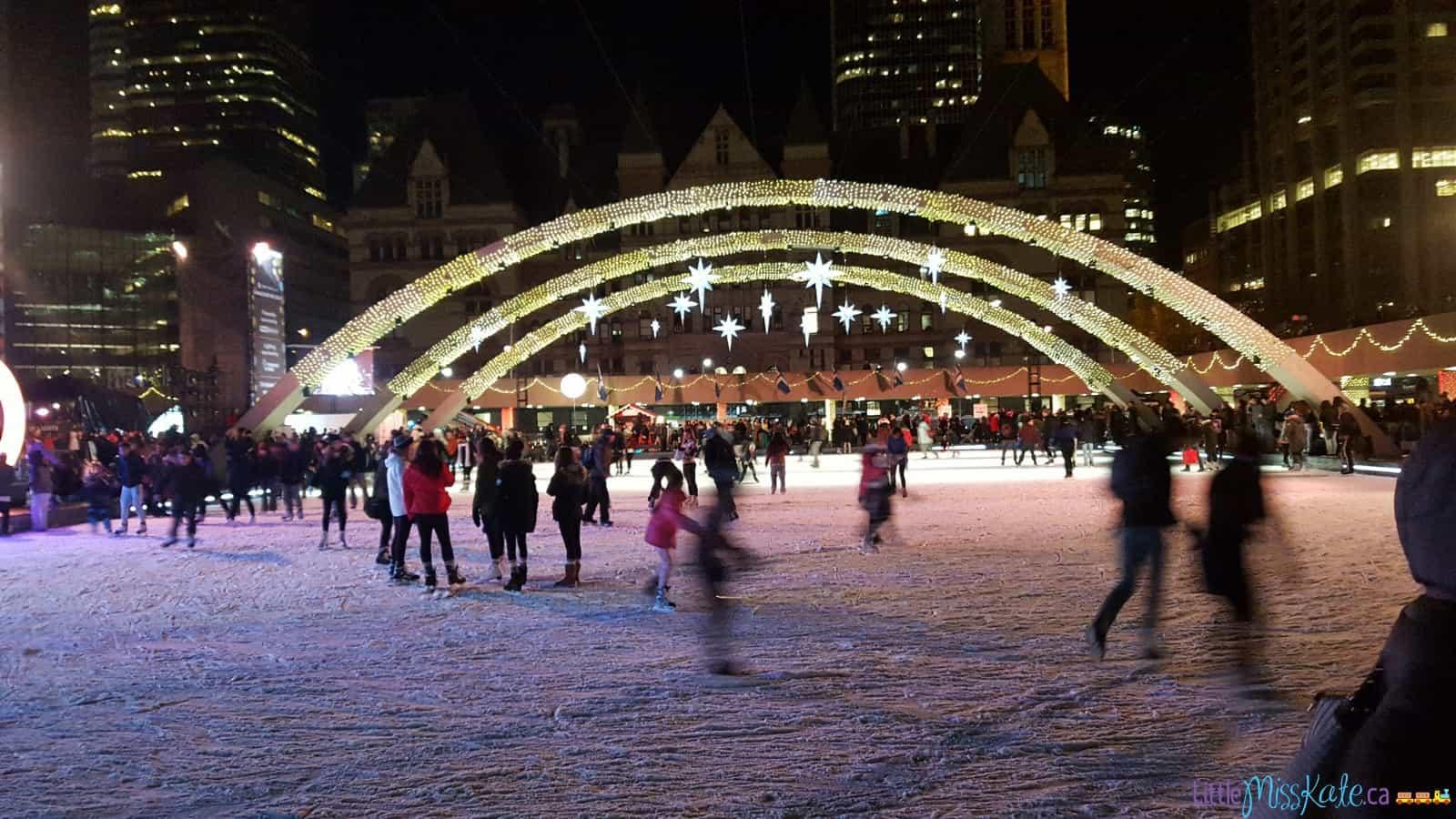 Outdoor-skating-rink-toronto-nathan-phillips-square-skating-at-night--1